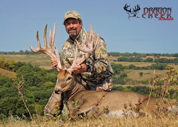 Happy whitetail hunter with his 230 class trophy buck