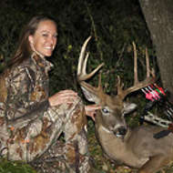 Female Bowhunter with Buck